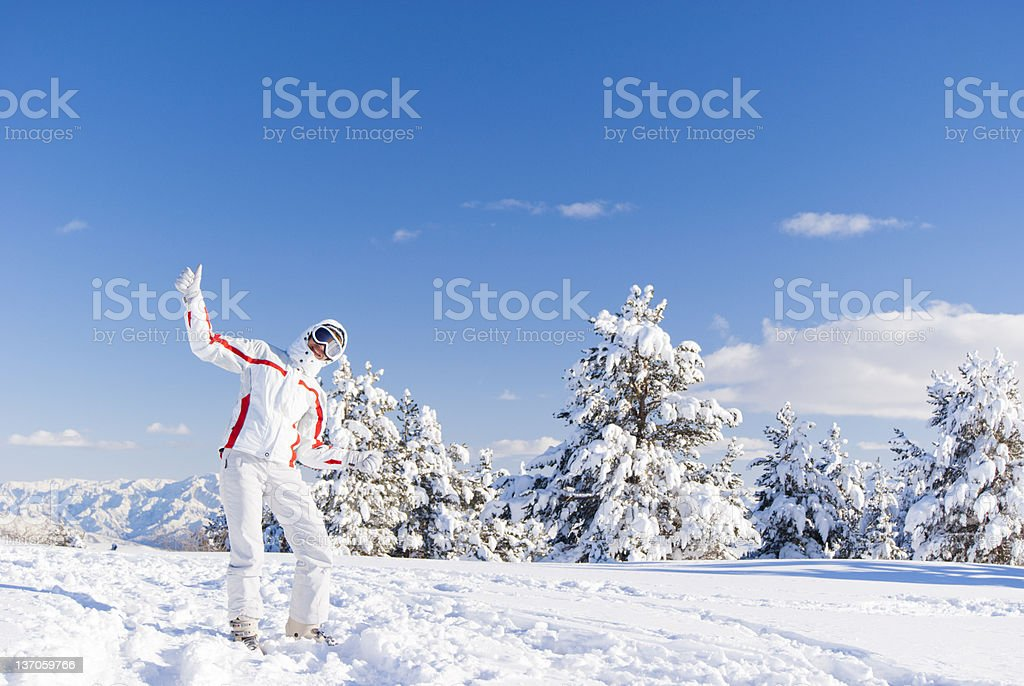 Happy skier on the top of mountain royalty-free stock photo