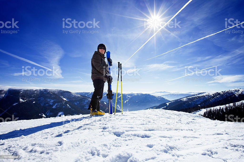 Happy skier standing on the snowy top royalty-free stock photo