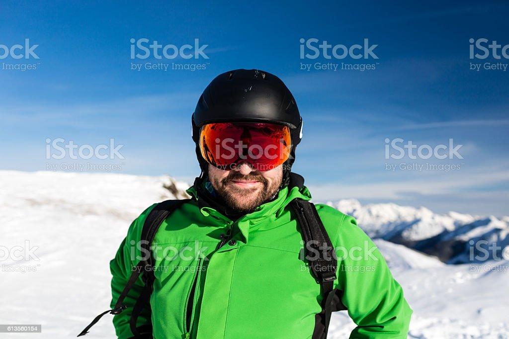 Happy skier with large oversized ski goggles stock photo