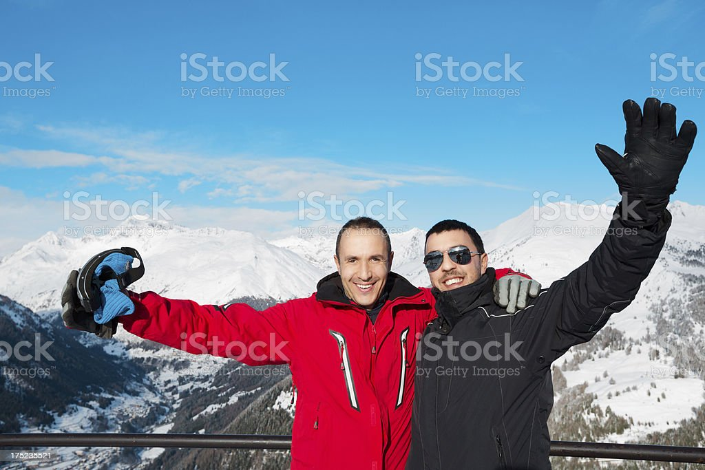 Happy skiers at the top of a mountain royalty-free stock photo