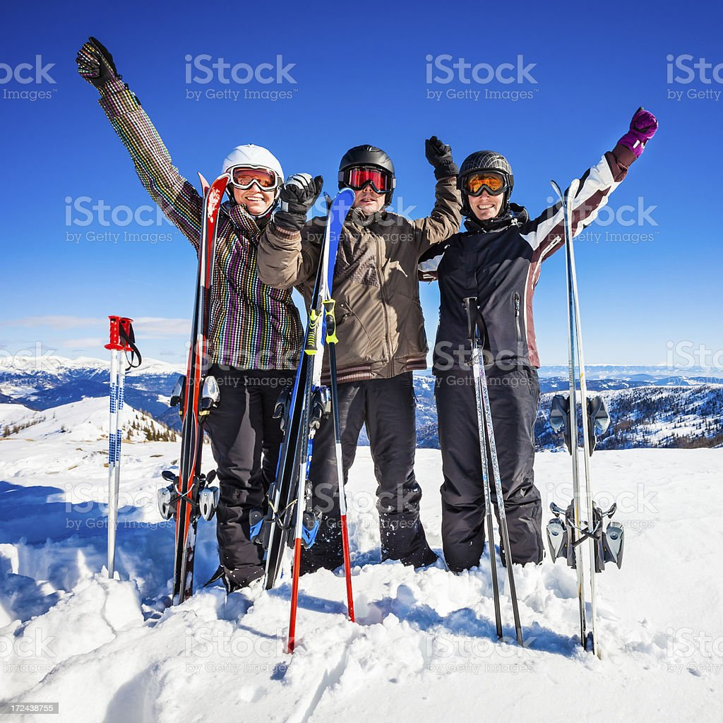Happy skiers on top of ski resort stock photo