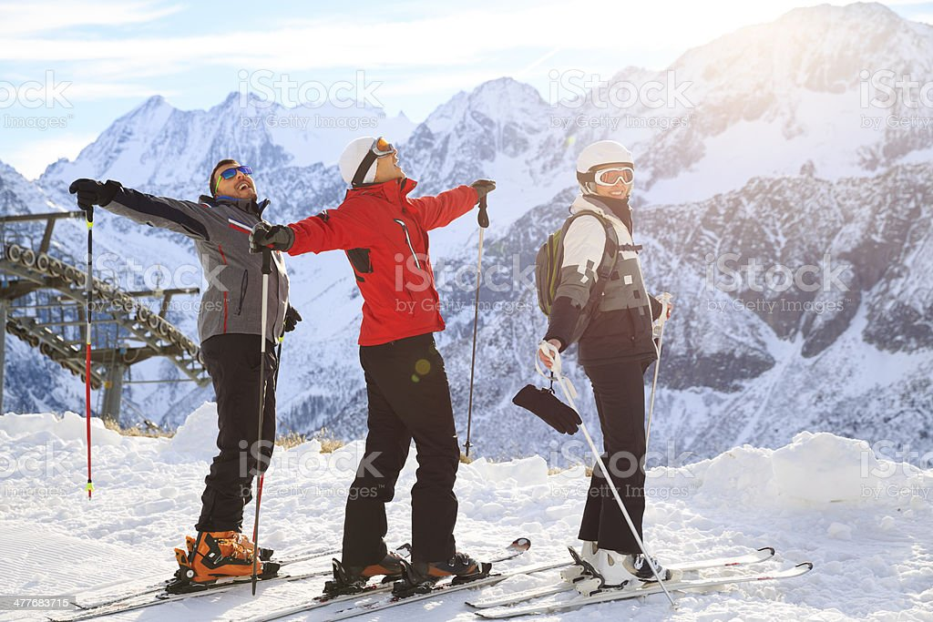 Happy skiing group on the mountain top stock photo