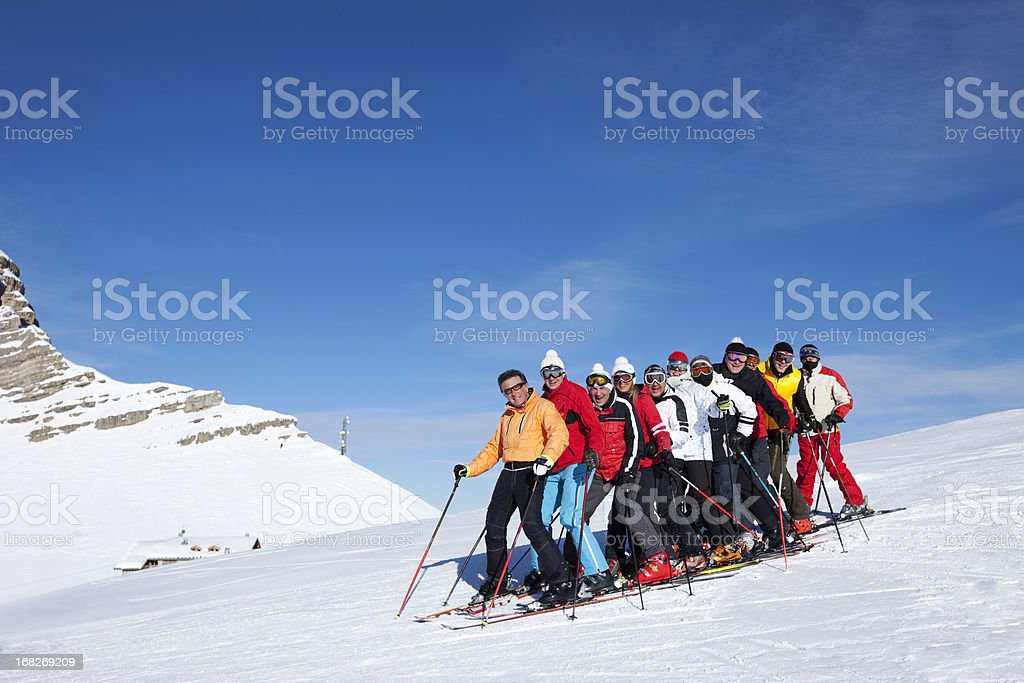 Happy skiing group royalty-free stock photo