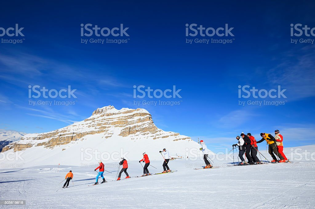 Happy skiing group  Ski school  Beautiful mountain landscape background stock photo