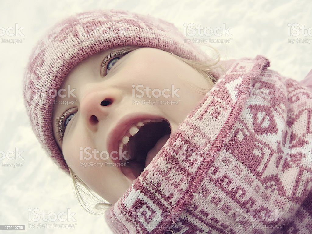 Happy small girl is laughing in winter stock photo