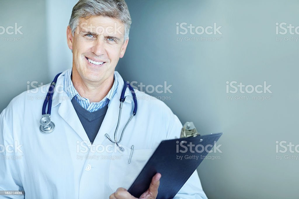 Happy smart doctor holding a notepad with copyspace royalty-free stock photo