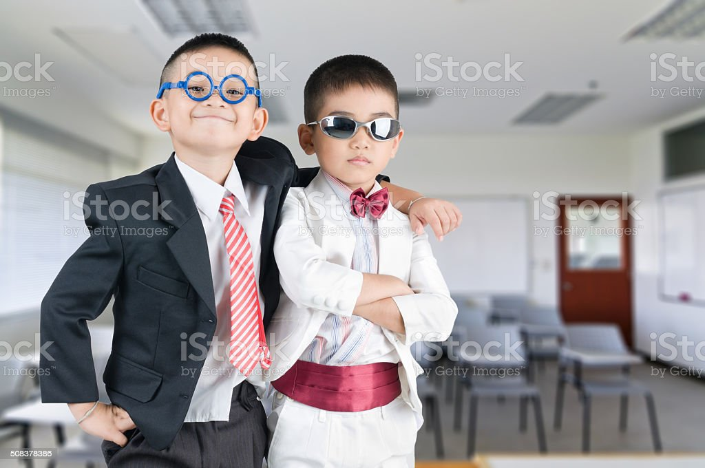Happy smile little business boy in classroom background stock photo