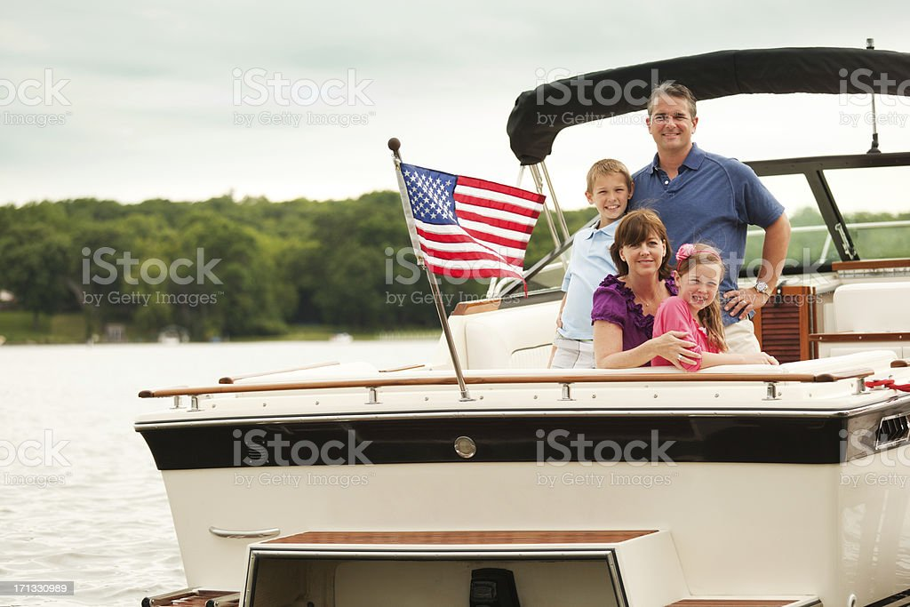 Happy, Smiling American Family Boating on Midwest Lake with Motorboat stock photo