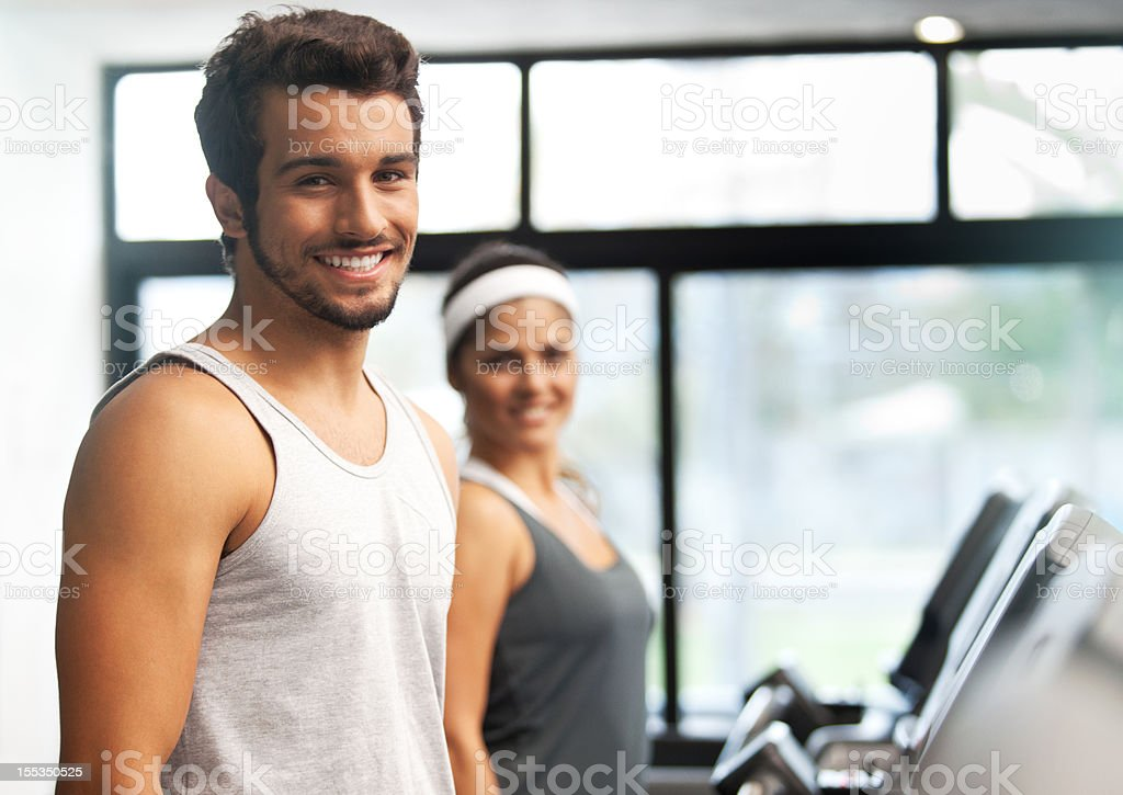Happy smiling and beautiful people running at the fitness club. royalty-free stock photo
