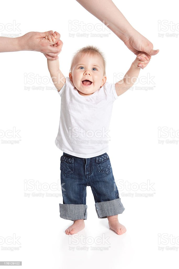 Happy Smiling Baby Learning to Walk Holding Mothers Hands royalty-free stock photo