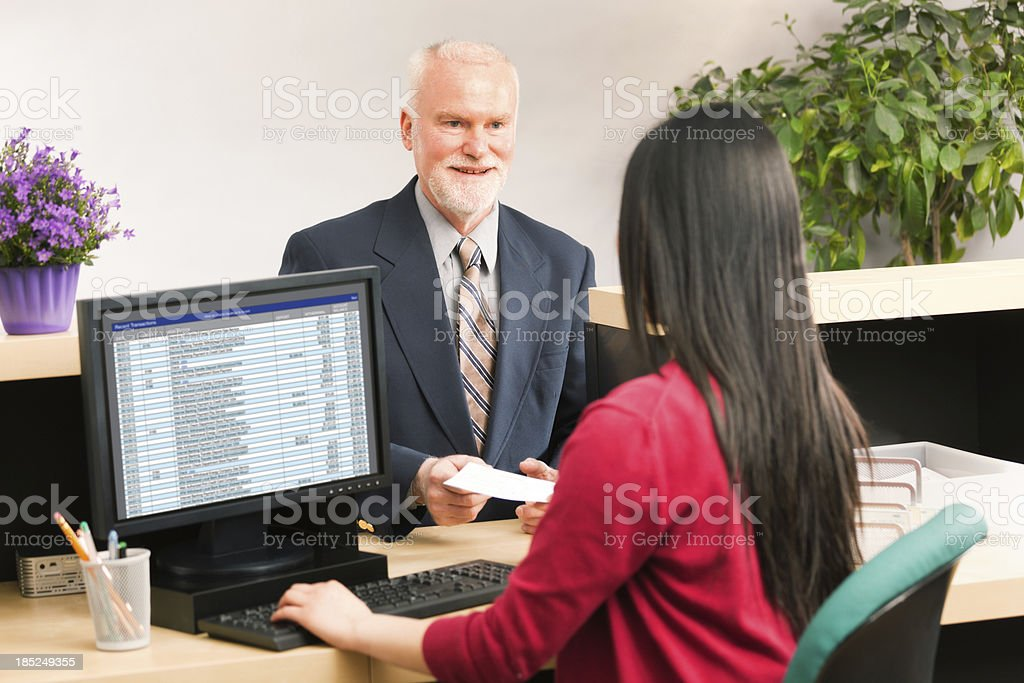 Happy Smiling Bank Teller with Customer Hz royalty-free stock photo