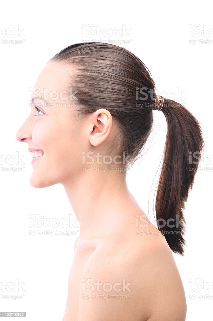 happy smiling beautiful young woman is looking sideways royalty-free stock photo