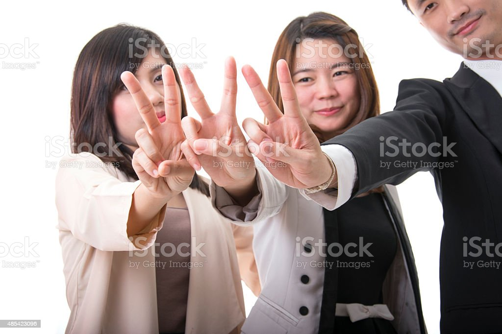 Happy Smiling Business People Showing Two Fingers Or Victory Ges royalty-free stock photo