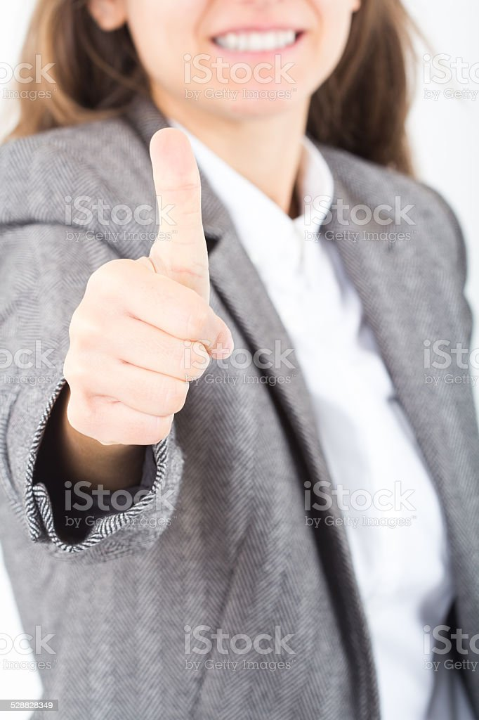 Happy smiling business woman with ok hand sign stock photo