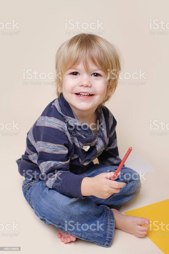 Happy Smiling Child doing Arts, with Crayon stock photo
