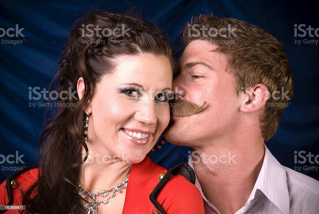 Happy & Smiling Couple: All American Man Kissing Beautiful Woman stock photo