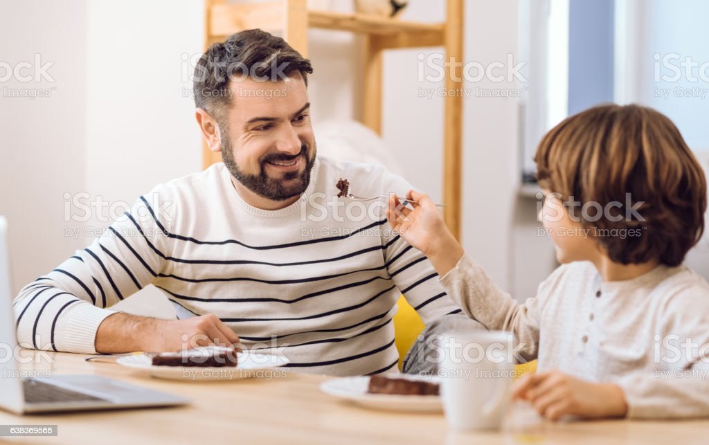 Happy smiling family eating together stock photo