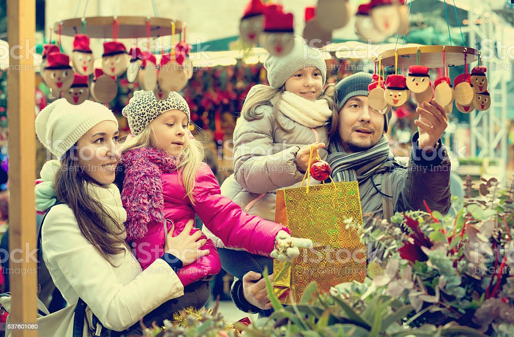 Happy smiling family of four buying Caga Tio stock photo