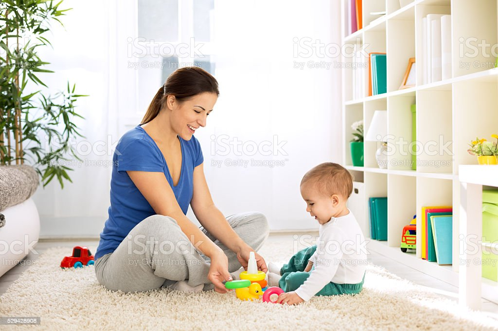 Happy smiling family playing with toys stock photo