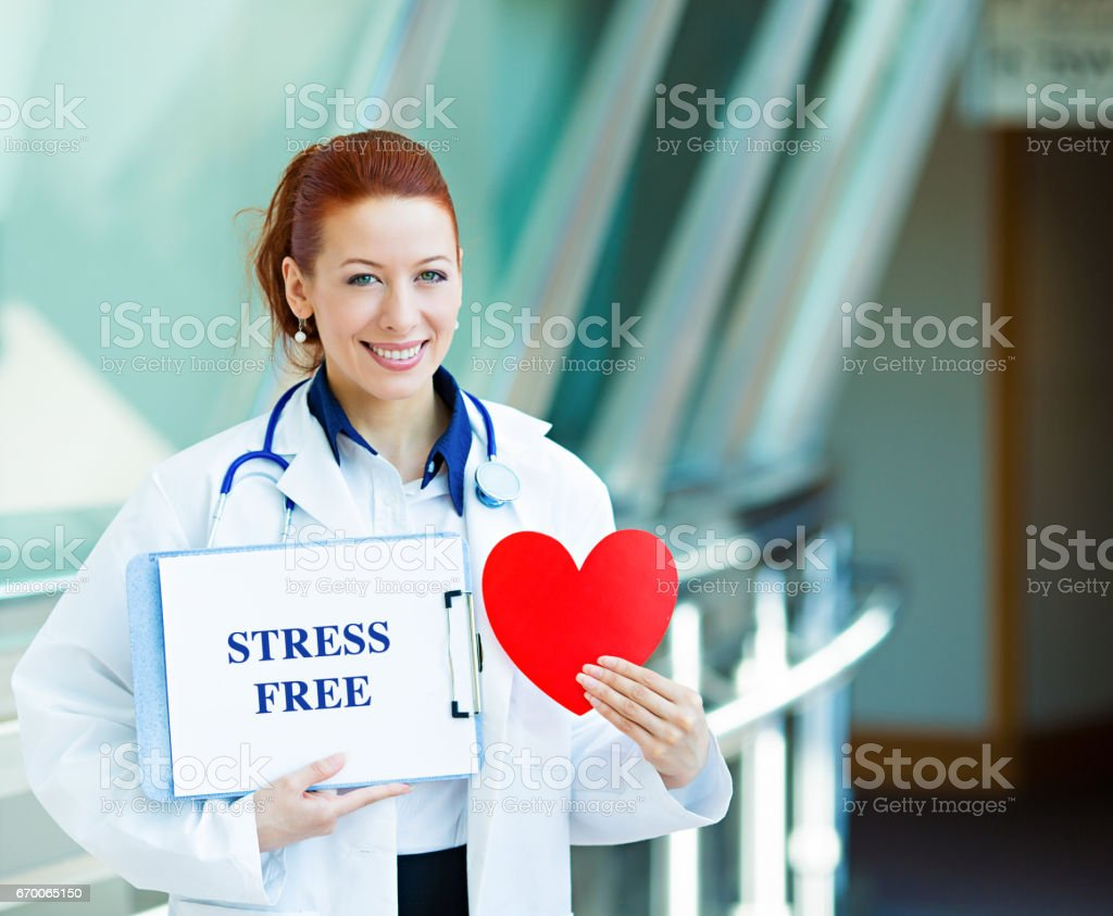 happy smiling female health care professional, woman family doctor, cardiologist stock photo