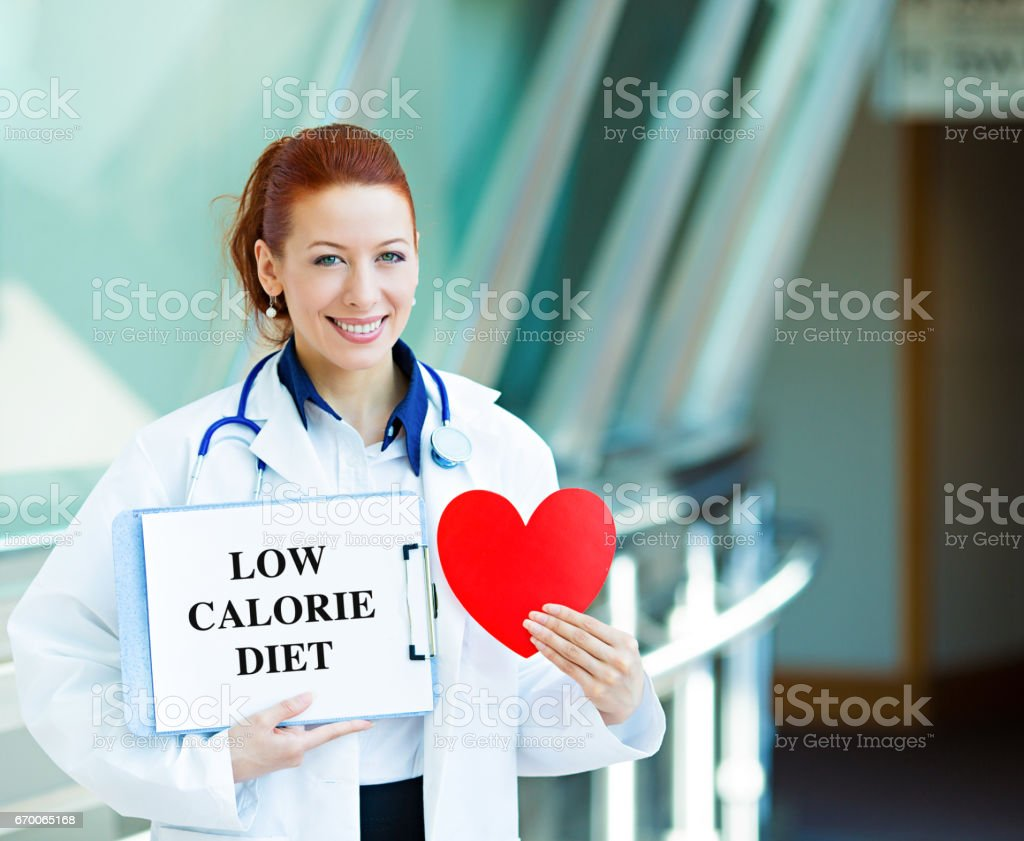 happy smiling female health care professional woman family doctor, cardiologist with stethoscope stock photo