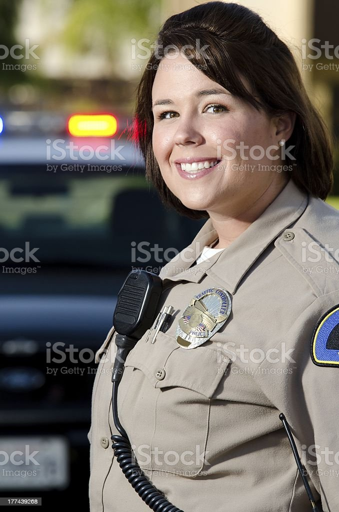 Happy smiling female police officer stock photo