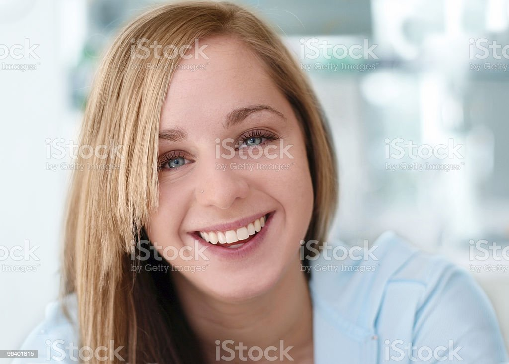 Happy smiling girl with blue background stock photo