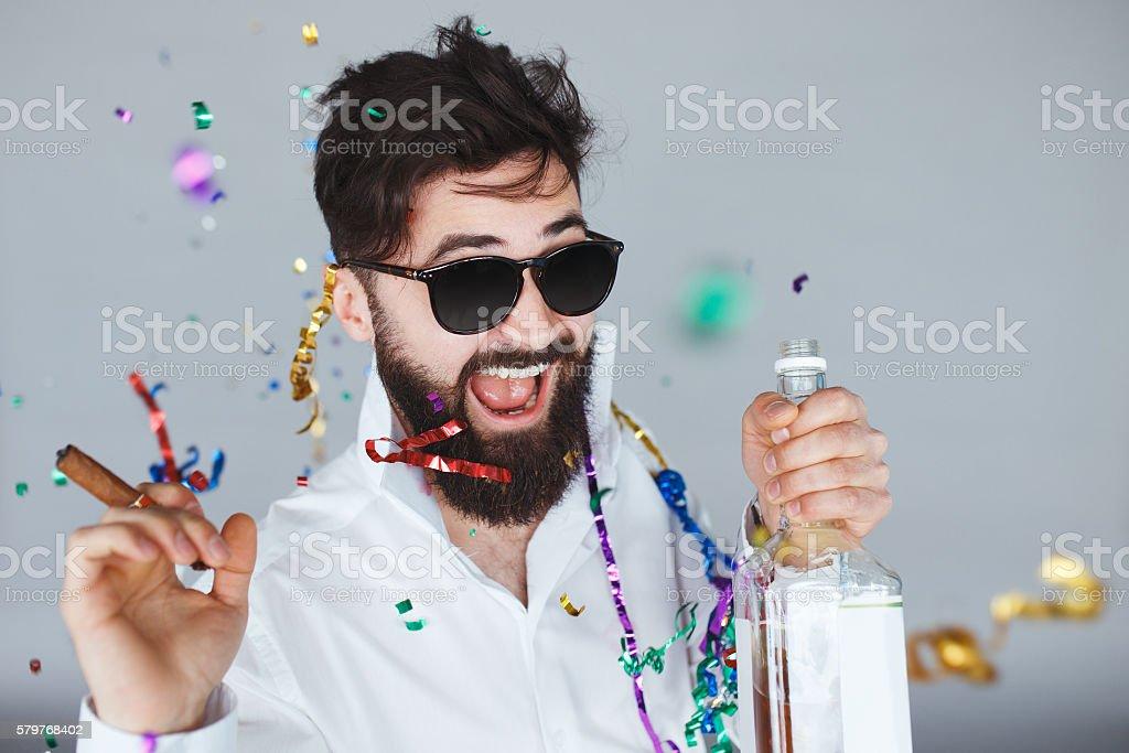 Happy smiling man celebrating new years eve stock photo