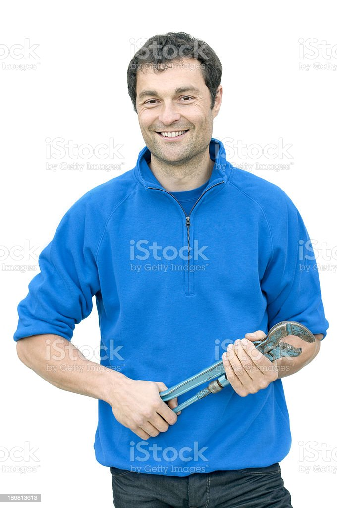 happy smiling man holding a pipe wrench royalty-free stock photo