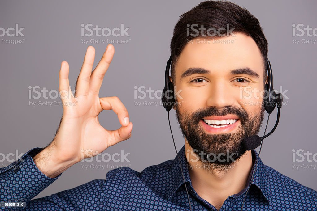 Happy smiling man in head-phones gesturing 'LIKE' stock photo
