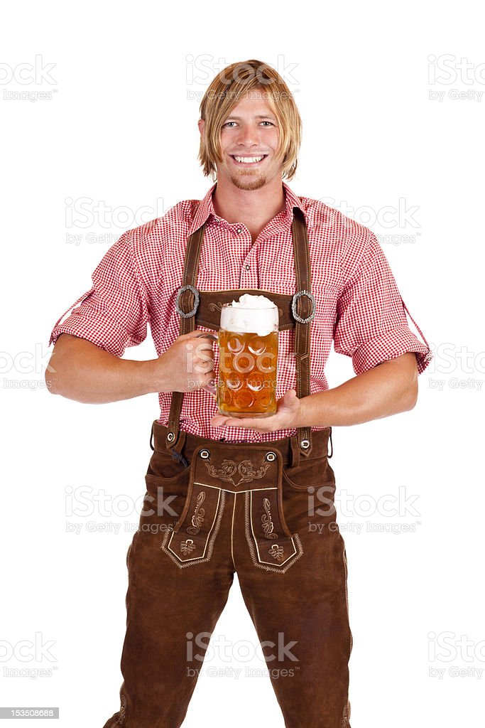 Happy smiling man with lederhose holds oktoberfest beer stein royalty-free stock photo