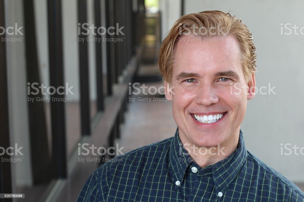 Happy smiling mature man in his forties with blond hair stock photo