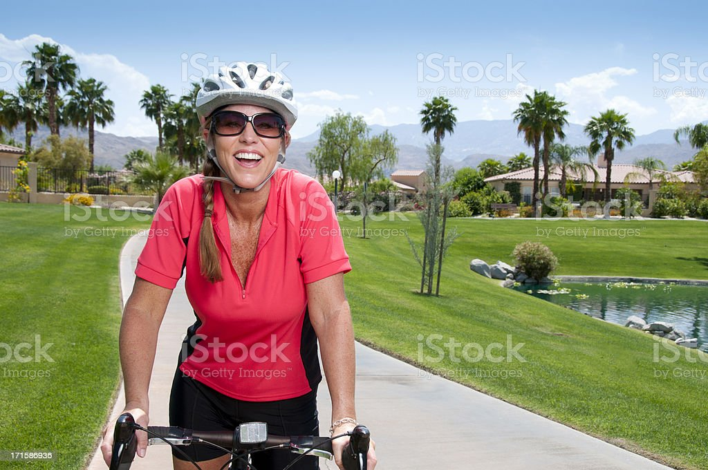 Happy Smiling Mature Woman On Her Bike stock photo