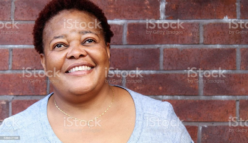 Happy , smiling mature woman stock photo