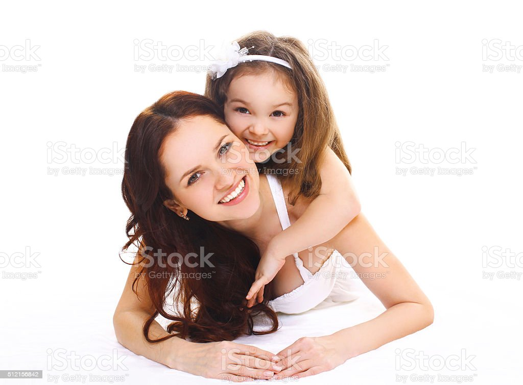 Happy smiling mother and little child daughter on a white stock photo