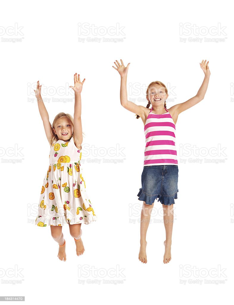 Happy Smiling Preteen Adolescent Girls Jumping on White Background royalty-free stock photo