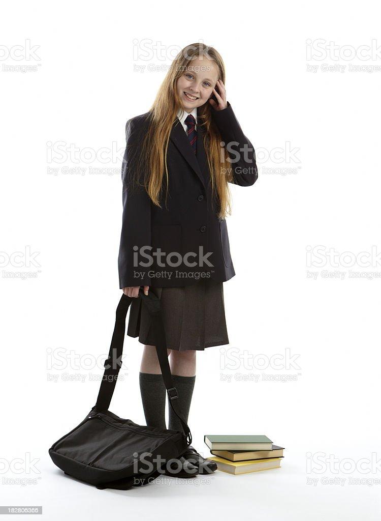 Happy smiling schoolgirl standing in uniform royalty-free stock photo