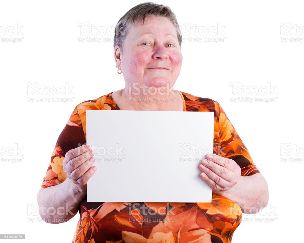 Happy smiling senior woman holding blank placard stock photo