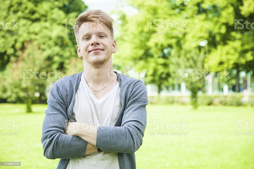 Happy smiling student with arms crossed royalty-free stock photo