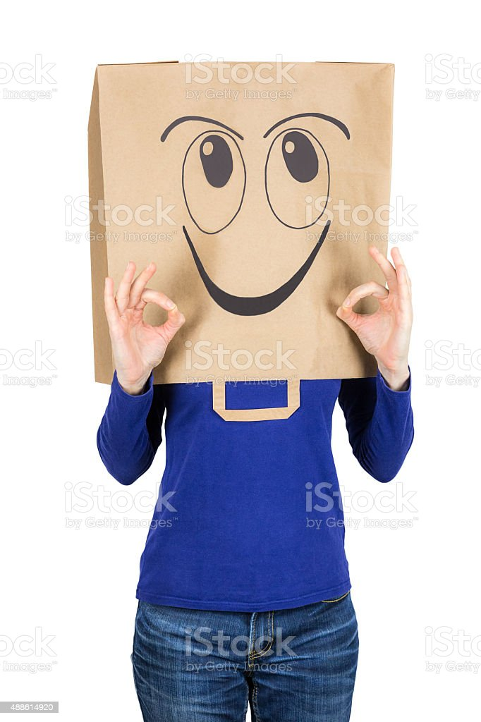 Happy smiling woman with paper bag on head stock photo