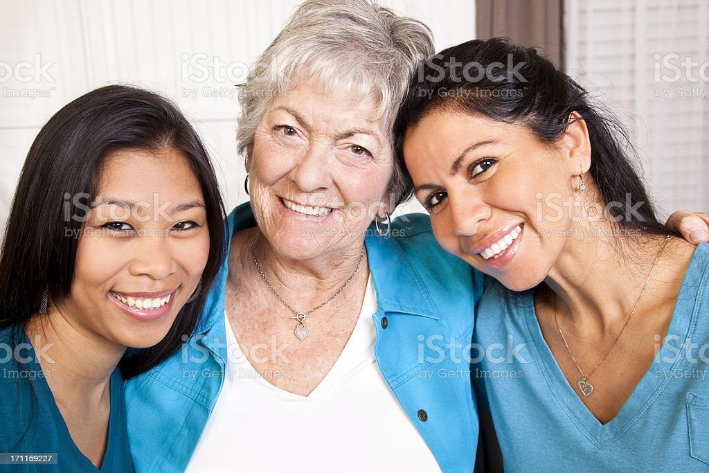 Happy smiling women. Multi-ethnic group. Mother, grandmother, friends. stock photo