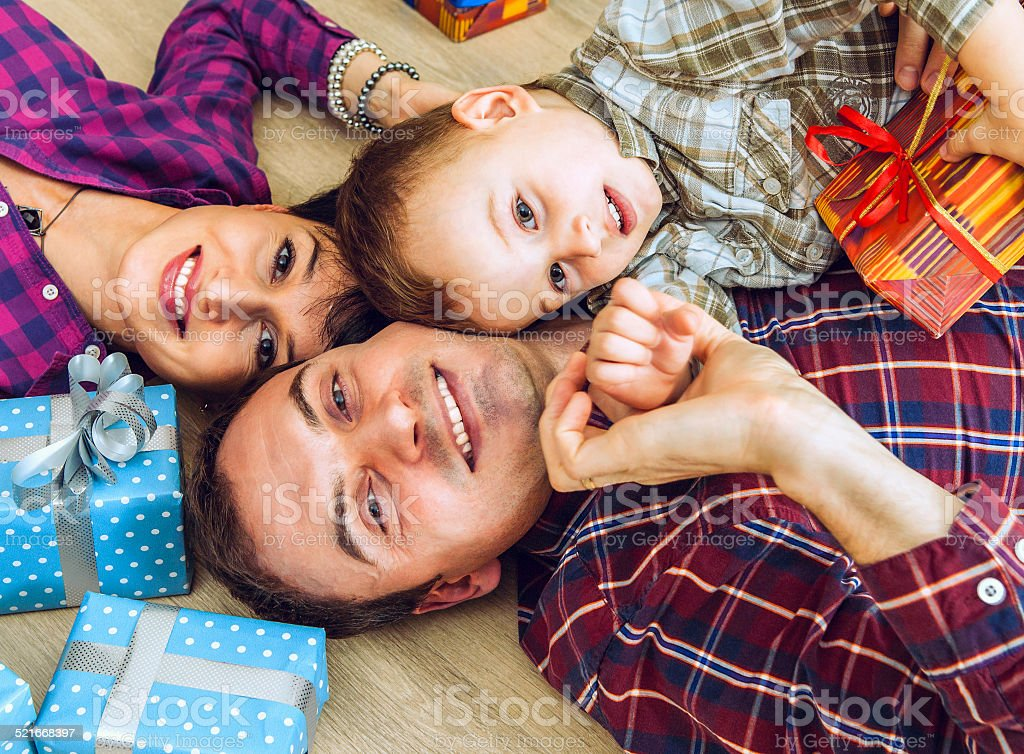 Happy smiling young family on the floor stock photo