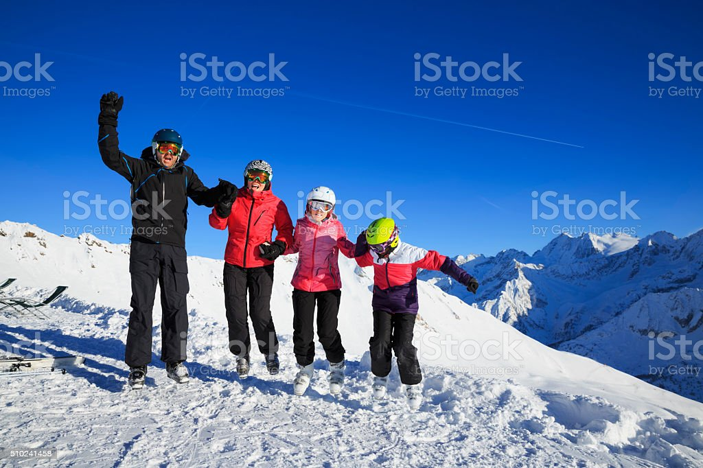 Happy Snow skier family mother and father with children  Alps stock photo