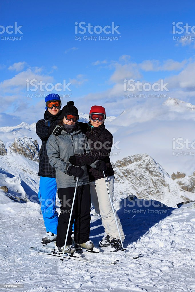 Happy Snow skier family mother with teen boy and girl stock photo