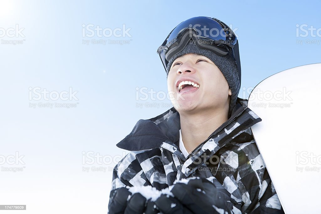 Happy snowboarder against blue sky royalty-free stock photo