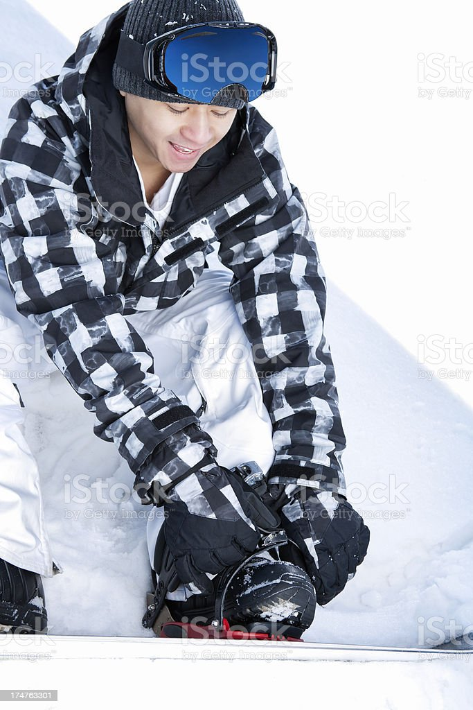 Happy snowboarder buckle binding royalty-free stock photo
