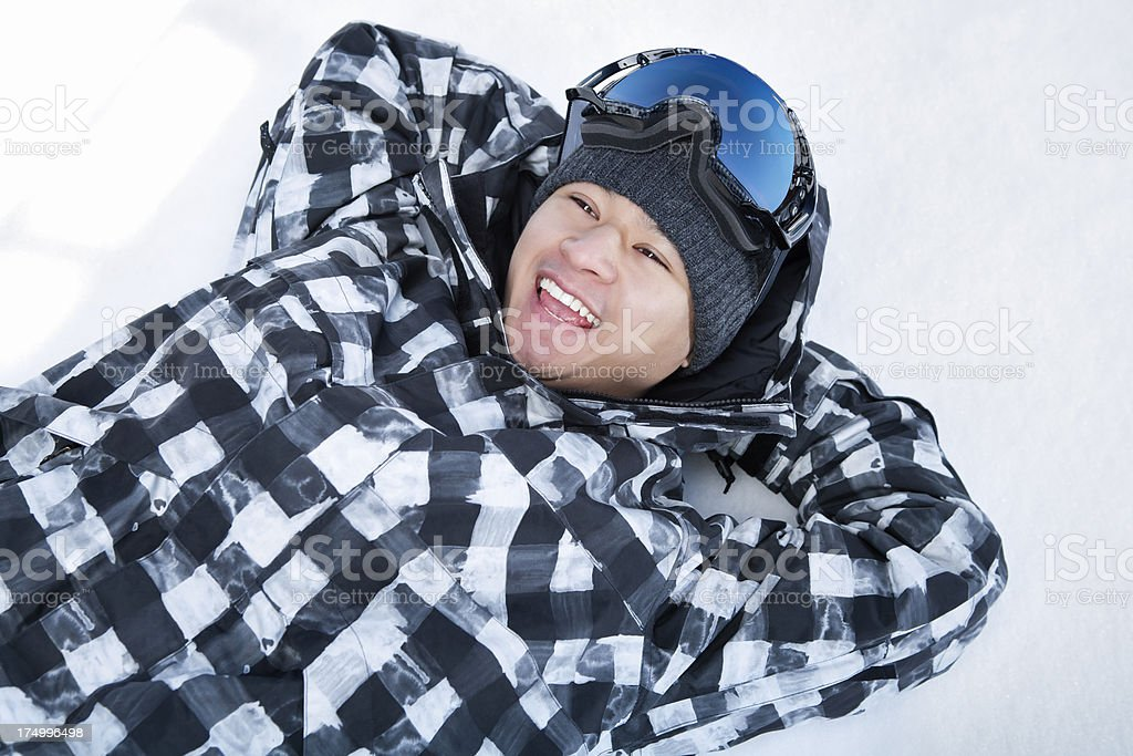 Happy snowboarder laying on snow royalty-free stock photo