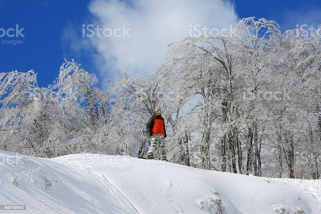 Happy Snowboarder Top of Snowy Mountain Nevados de Chillan Chile stock photo