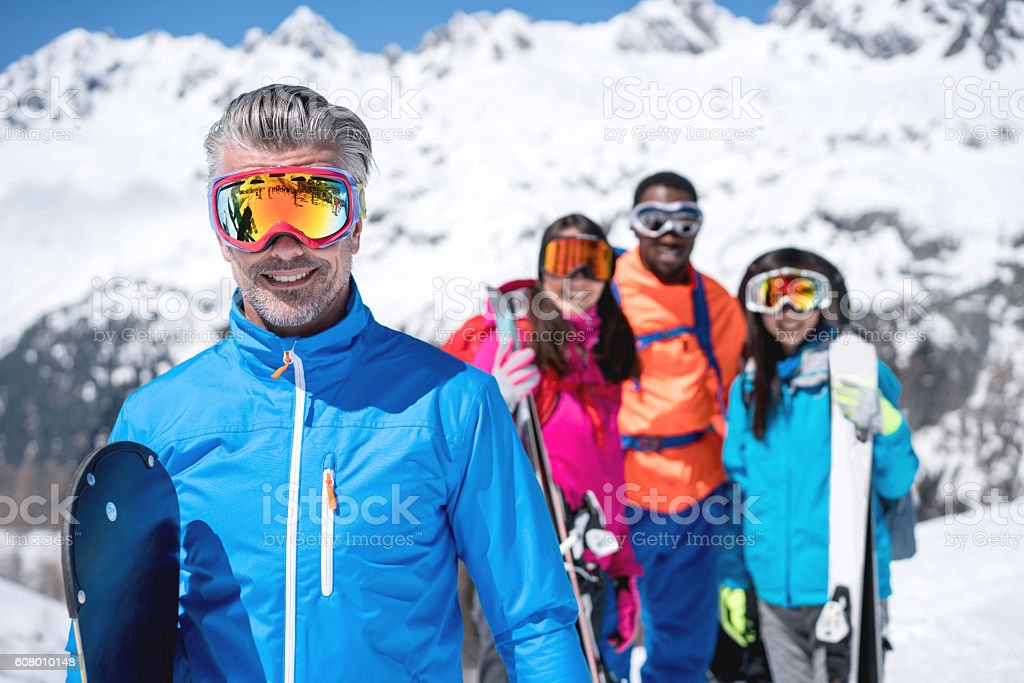 Happy snowboarding instructor stock photo