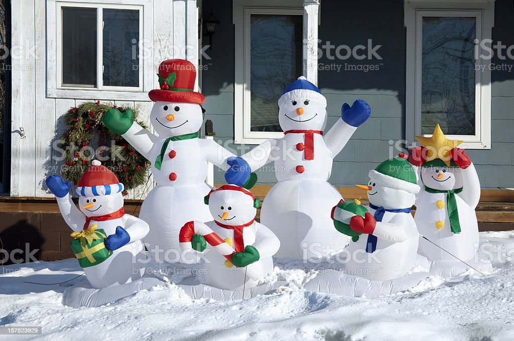 Happy Snowman Family Enjoying Winter Day Together in Snow, Sunshine royalty-free stock photo